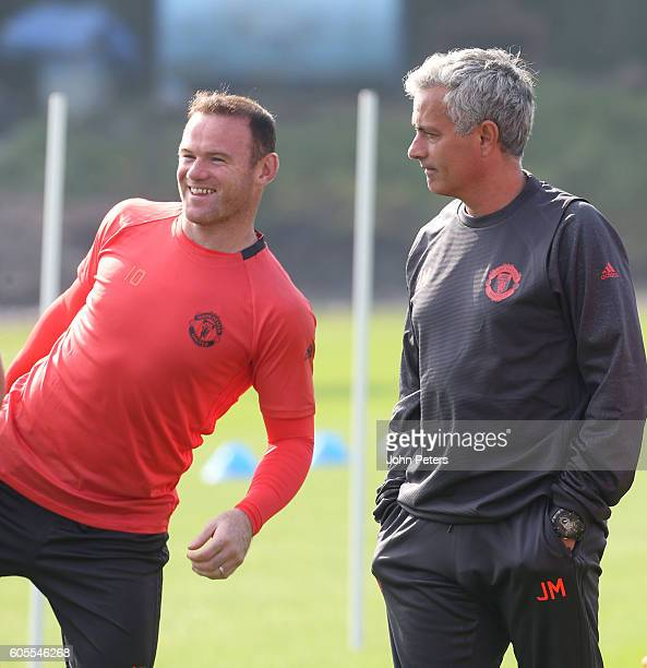 Manchester United Manager Jose Mourinho and Wayne Rooney look on during a Manchester United training session at Aon Training Complex on September 14...
