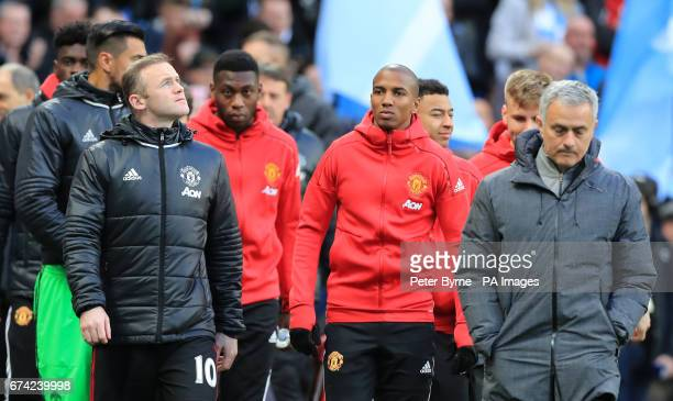 Manchester United manager Jose Mourinho and Wayne Rooney walk out at the start of the Premier League match at the Etihad Stadium Manchester