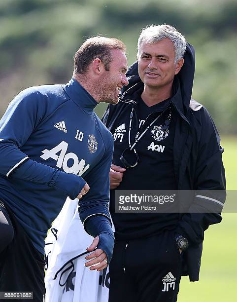 Manchester United Manager Jose Mourinho chats to Wayne Rooney during a first team training session at Aon Training Complex on August 12 2016 in...