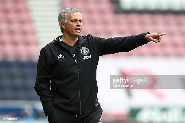 Manchester United manager Jose Mourinho gestures from the touchine during the pre season friendly match between Wigan Athletic and Manchester United...