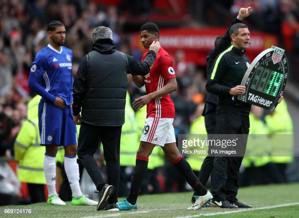 Manchester United manager Jose Mourinho gives Manchester United's Marcus Rashford a pat on the back as he is substituted during the Premier League...