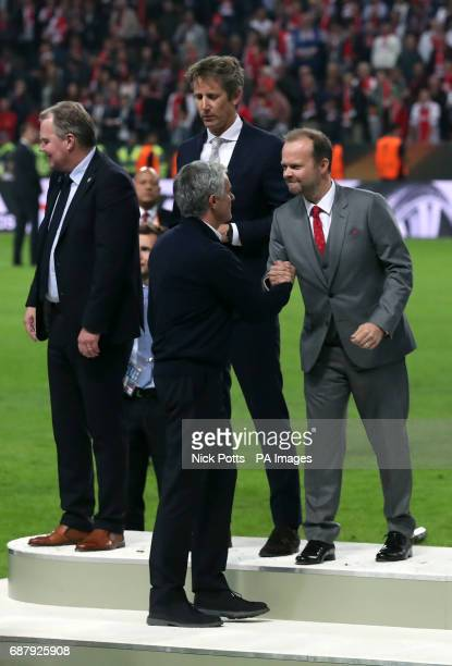 Manchester United manager Jose Mourinho is congratulated by chief executive Ed Woodward after winning the UEFA Europa League Final at the Friends...