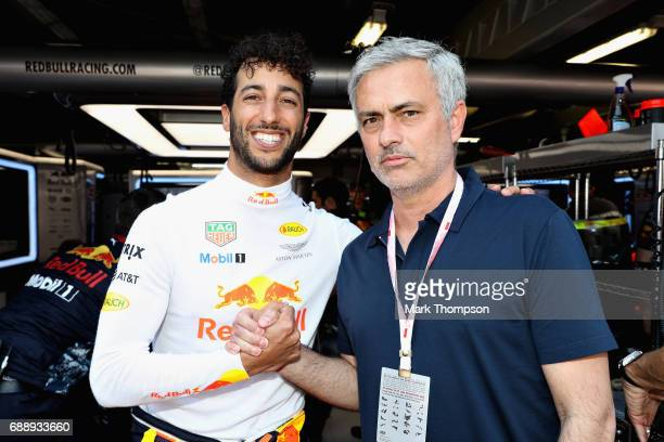 Manchester United manager Jose Mourinho of Portugal in the Red Bull Racing garage with Daniel Ricciardo of Australia and Red Bull Racing during...