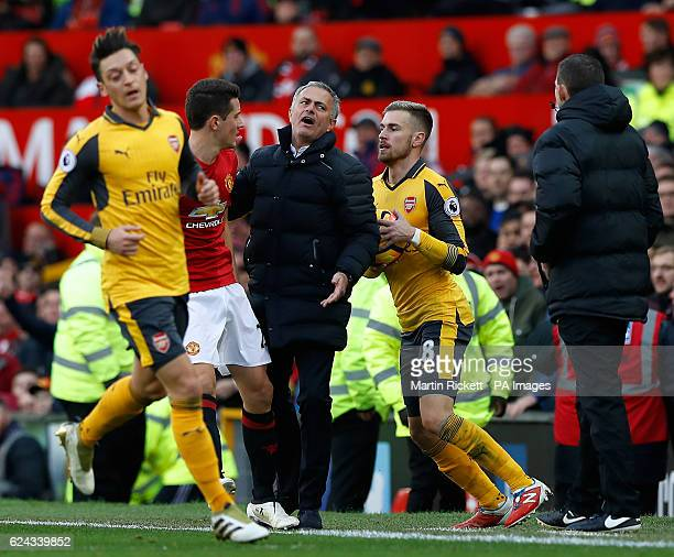 Manchester United manager Jose Mourinho seperates Manchester United's Ander Herrera and Arsenal's Aaron Ramsey during the Premier League match at Old...