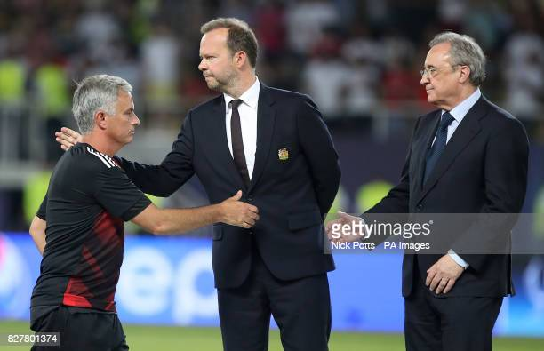 Manchester United manager Jose Mourinho shakes hands with Manchester United vicechairman Ed Woodward and Read Madrid president Florentino Perez after...