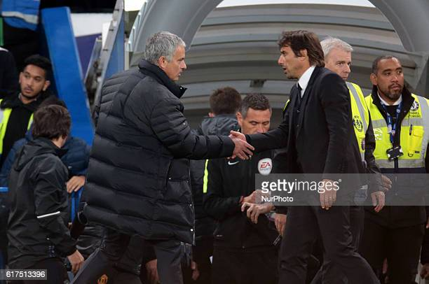Manchester United manager Jose Mourinho shanks hands with Chelsea manager Antonio Conte during the EPL Premier League match between Chelsea and...