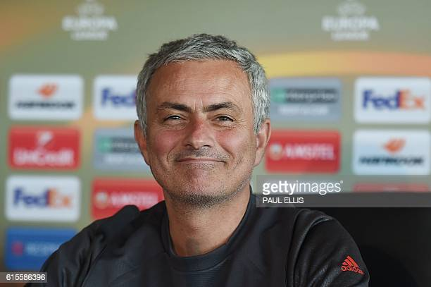 Manchester United manager Jose Mourinho smiles during a press conference at their Carrington base in Manchester northwest England on October 19 2016...