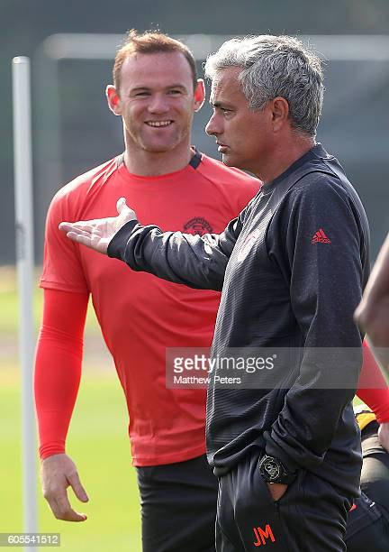 Manchester United Manager Jose Mourinho speaks as Wayne Rooney looks on during a Manchester United training session at Aon Training Complex on...