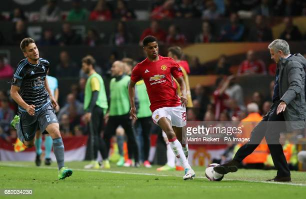 Manchester United manager Jose Mourinho takes the ball from Marcus Rashford after a freekick was given by the referee during the UEFA Europa League...