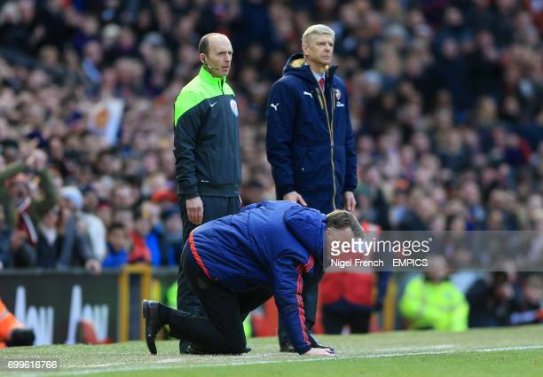 Manchester United manager Louis Van Gaal and Arsenal manager Arsene Wenger stand at the touchline