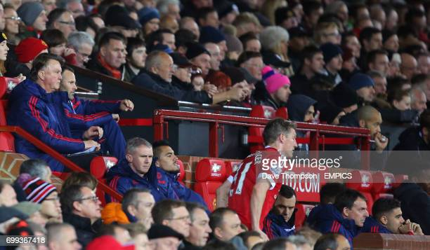 Manchester United manager Louis van Gaal and Ryan Giggs look on as Manchester United's Bastian Schweinsteiger comes off the pitch