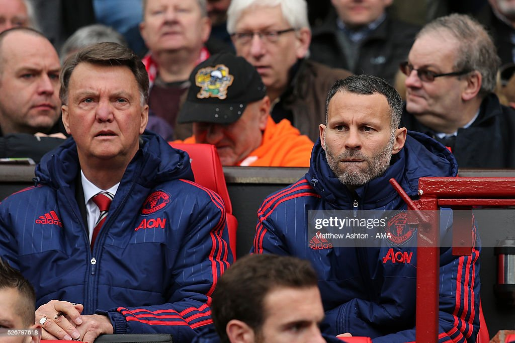 Manchester United Manager Louis van Gaal looks on with Assistant <a gi-track='captionPersonalityLinkClicked' href=/galleries/search?phrase=Ryan+Giggs&family=editorial&specificpeople=201666 ng-click='$event.stopPropagation()'>Ryan Giggs</a> (R) during the Barclays Premier League match between Manchester United and Leicester City at Old Trafford on May 1, 2016 in Manchester, United Kingdom.