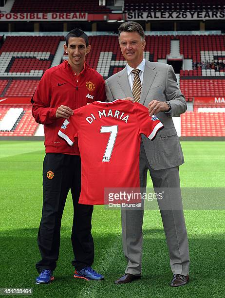 Manchester United manager Louis Van Gaal poses for a photograph next to new signing Angel Di Maria at Old Trafford on August 28 2014 in Manchester...