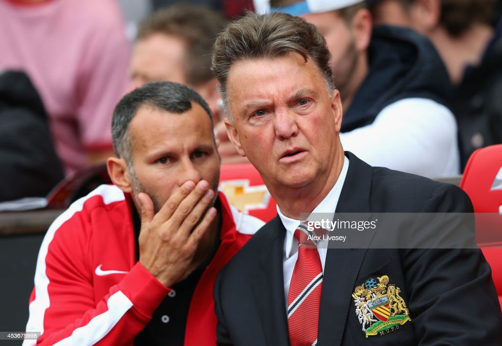 Manchester United Manager Louis van Gaal speaks with Assistant <a gi-track='captionPersonalityLinkClicked' href=/galleries/search?phrase=Ryan+Giggs&family=editorial&specificpeople=201666 ng-click='$event.stopPropagation()'>Ryan Giggs</a> (L) prior to the Barclays Premier League match between Manchester United and Swansea City at Old Trafford on August 16, 2014 in Manchester, England.