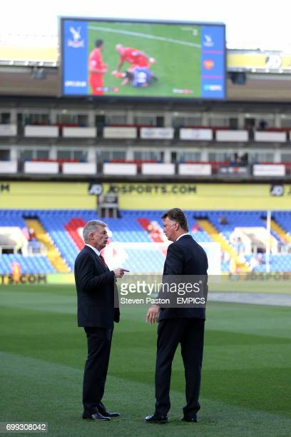 Manchester United manager Louis van Gaal with medical and sports science coordinator Jos van Dijk on the pitch before the game
