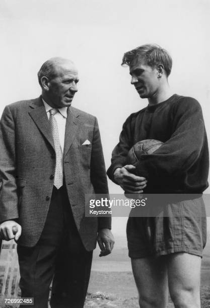 Manchester United manager Matt Busby with midfielder Bobby Charlton during a training session prior to their FA Cup final match against Bolton...