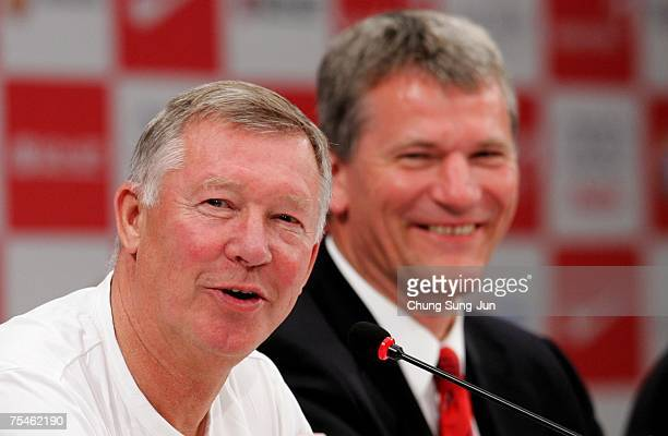 Manchester United Manager Sir Alex Ferguson and CEO David Gill attend a press conference upon their arrival at the Shilla Hotel as part of the first...