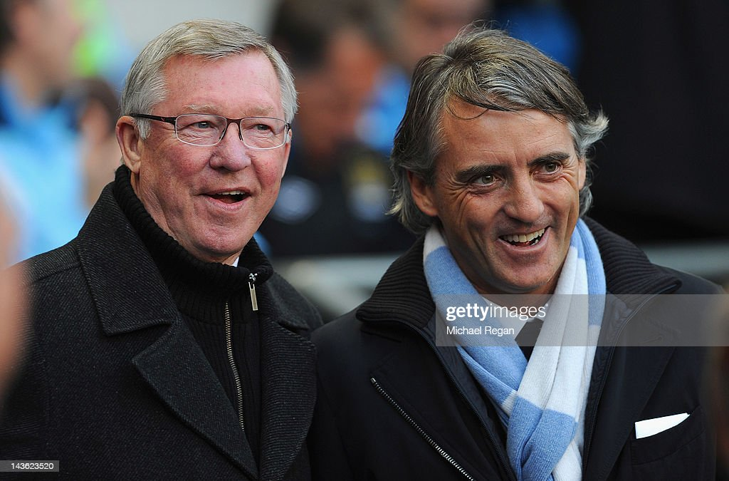 Manchester United manager Sir Alex Ferguson and Manchester City manager Roberto Mancini look on before the Barclays Premier League match between Manchester City and Manchester United at Etihad Stadium on April 30, 2012 in Manchester, England.