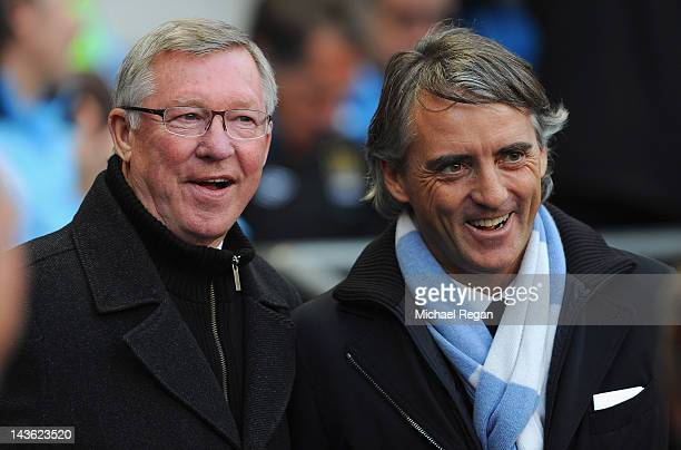 Manchester United manager Sir Alex Ferguson and Manchester City manager Roberto Mancini look on before the Barclays Premier League match between...