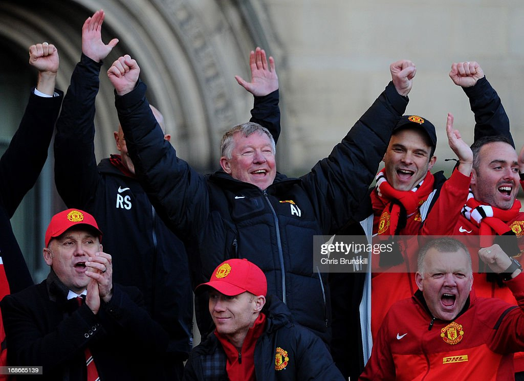 Manchester United manager Sir Alex Ferguson celebrates during the Manchester United Premier League Winners Parade at Manchester Town Hall on May 13, 2013 in Manchester, England.