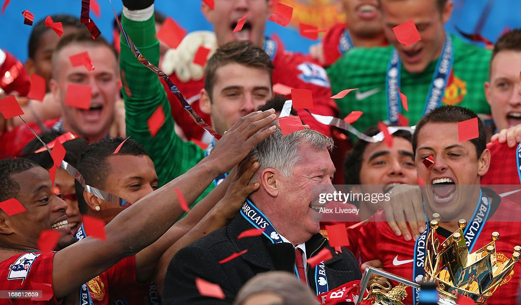 Manchester United Manager Sir <a gi-track='captionPersonalityLinkClicked' href=/galleries/search?phrase=Alex+Ferguson&family=editorial&specificpeople=203067 ng-click='$event.stopPropagation()'>Alex Ferguson</a> celebrates with his players and the Premier League trophy following the Barclays Premier League match between Manchester United and Swansea City at Old Trafford on May 12, 2013 in Manchester, England.