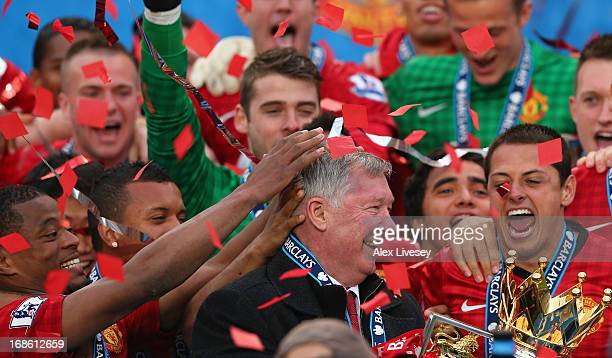 Manchester United Manager Sir Alex Ferguson celebrates with his players and the Premier League trophy following the Barclays Premier League match...