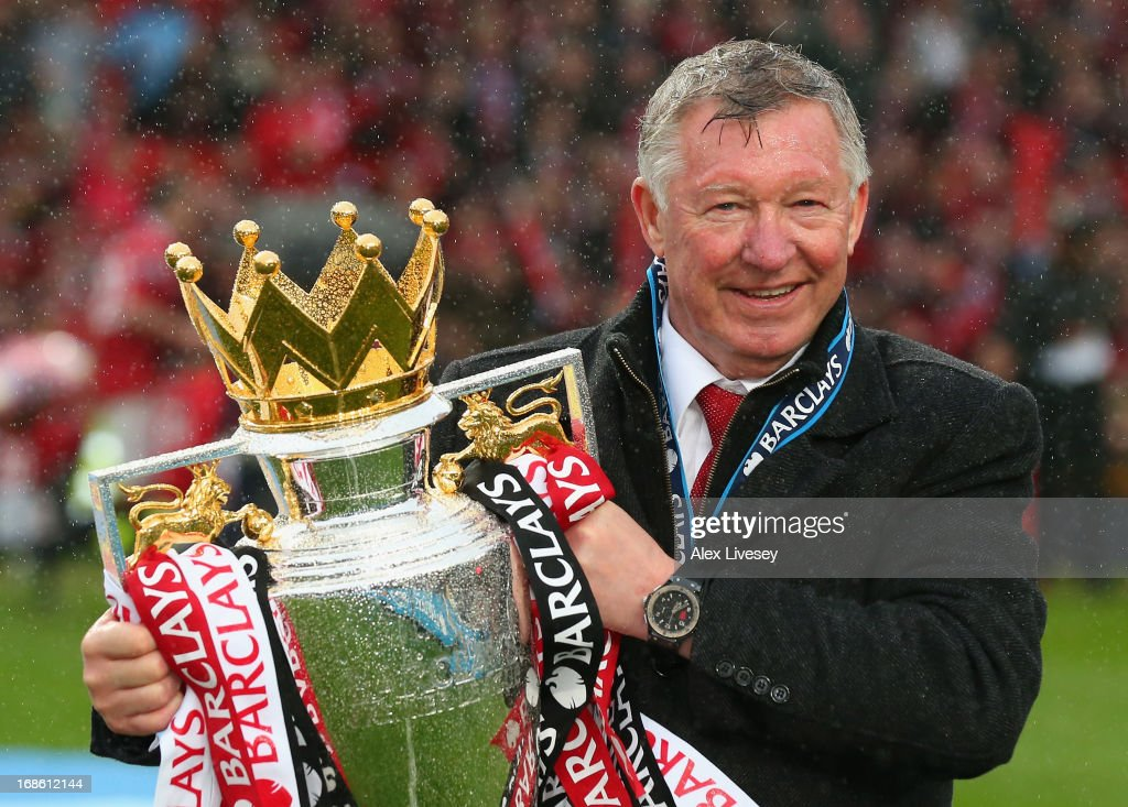 Manchester United Manager Sir <a gi-track='captionPersonalityLinkClicked' href=/galleries/search?phrase=Alex+Ferguson&family=editorial&specificpeople=203067 ng-click='$event.stopPropagation()'>Alex Ferguson</a> celebrates with the Premier League trophy following the Barclays Premier League match between Manchester United and Swansea City at Old Trafford on May 12, 2013 in Manchester, England.