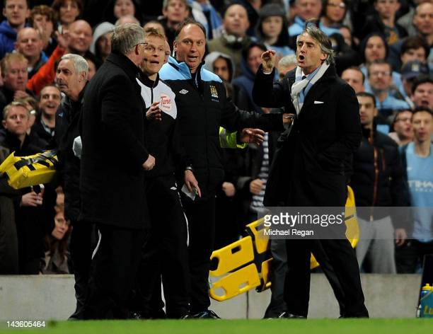 Manchester United Manager Sir Alex Ferguson clashes with Manchester City Manager Roberto Mancini during the Barclays Premier League match between...