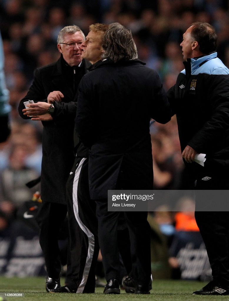 Manchester United Manager Sir Alex Ferguson clashes with Manchester City Manager Roberto Mancini (R) during the Barclays Premier League match between Manchester City and Manchester United at the Etihad Stadium on April 30, 2012 in Manchester, England.