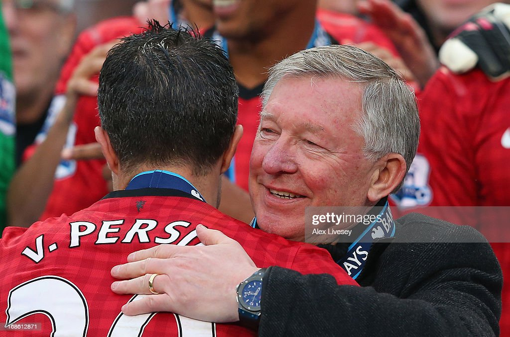 Manchester United Manager Sir Alex Ferguson congratulates Robin van Persie following the Barclays Premier League match between Manchester United and...