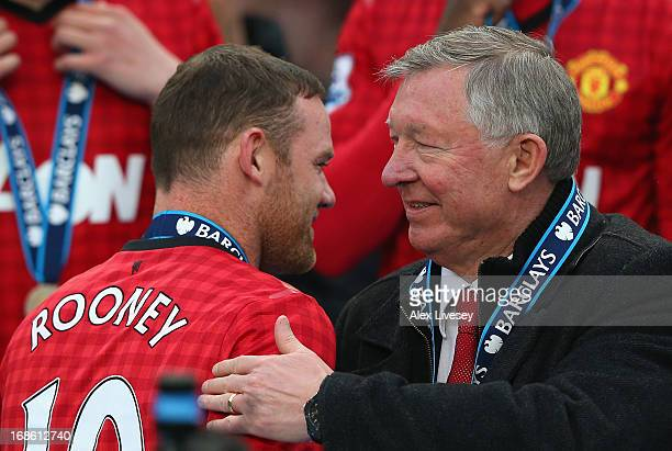 Manchester United Manager Sir Alex Ferguson congratulates Wayne Rooney following the Barclays Premier League match between Manchester United and...