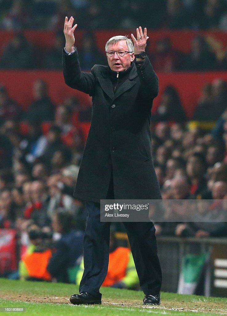 Manchester United Manager Sir Alex Ferguson encourages the crowd to show their support during the UEFA Champions League Round of 16 Second leg match between Manchester United and Real Madrid at Old Trafford on March 5, 2013 in Manchester, United Kingdom.
