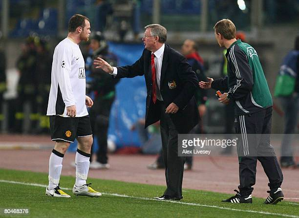 Manchester United Manager Sir Alex Ferguson has words with Wayne Rooney of Manchester United during the UEFA Champions League Quarter Final first leg...