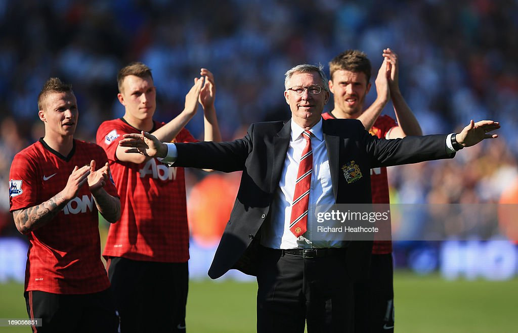 Manchester United manager Sir Alex Ferguson is applauded by players after his 1,500th and final match in charge of the club following the Barclays Premier League match between West Bromwich Albion and Manchester United at The Hawthorns on May 19, 2013 in West Bromwich, England.