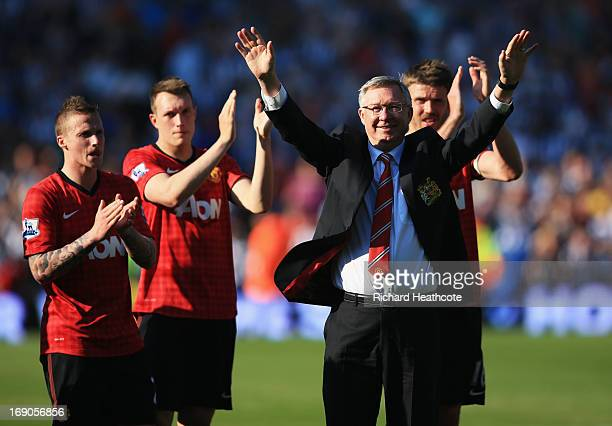 Manchester United manager Sir Alex Ferguson is applauded by players after his 1500th and final match in charge of the club following the Barclays...