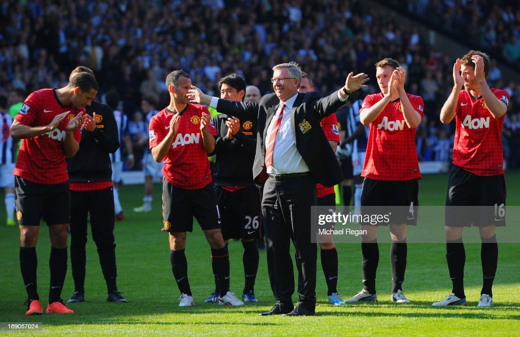 Manchester United manager Sir <a gi-track='captionPersonalityLinkClicked' href=/galleries/search?phrase=Alex+Ferguson&family=editorial&specificpeople=203067 ng-click='$event.stopPropagation()'>Alex Ferguson</a> is applauded by players after his 1,500th and final match in charge of the club following the Barclays Premier League match between West Bromwich Albion and Manchester United at The Hawthorns on May 19, 2013 in West Bromwich, England.