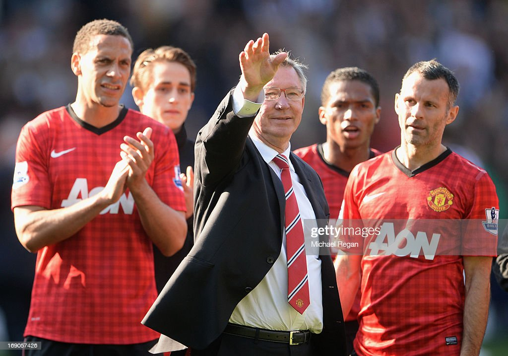 Manchester United manager Sir Alex Ferguson is applauded by players Rio Ferdinand and Ryan Giggs after his 1,500th and final match in charge of the club following the Barclays Premier League match between West Bromwich Albion and Manchester United at The Hawthorns on May 19, 2013 in West Bromwich, England.