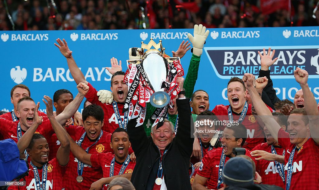 Manchester United Manager Sir <a gi-track='captionPersonalityLinkClicked' href=/galleries/search?phrase=Alex+Ferguson&family=editorial&specificpeople=203067 ng-click='$event.stopPropagation()'>Alex Ferguson</a> lifts the Premier League trophy following the Barclays Premier League match between Manchester United and Swansea City at Old Trafford on May 12, 2013 in Manchester, England.