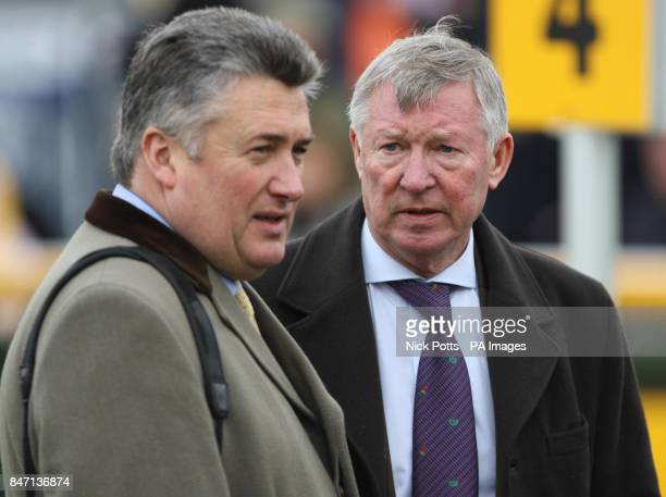 Manchester United Manager Sir Alex Ferguson owner of What a Friend with trainer Paul Nicholls after their horse failed to finish in the top three of...
