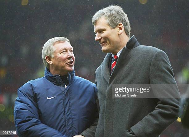 Manchester United manager Sir Alex Ferguson shakes hands with Chief executive David Gill before the FA Barclaycard Premiership match between...
