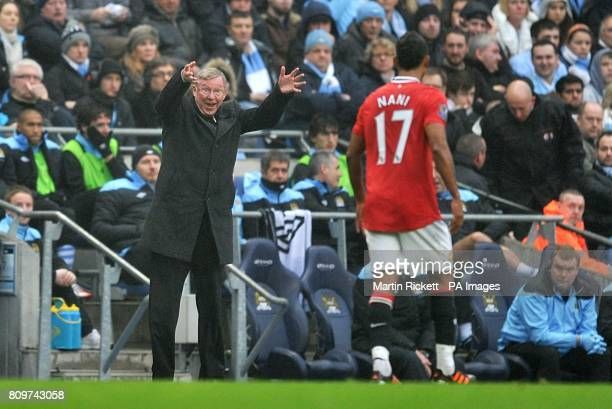 Manchester United manager Sir Alex Ferguson shows his frustrations to Luis Nani from the touchline
