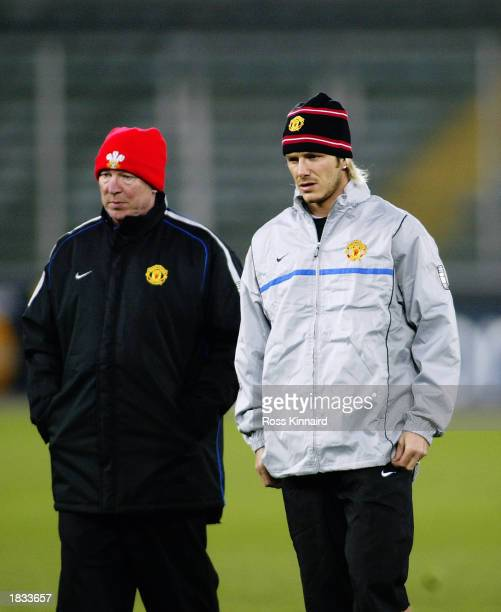 Manchester United Manager Sir Alex Ferguson talks with David Beckham of Manchester United during a training session for the Champions League second...