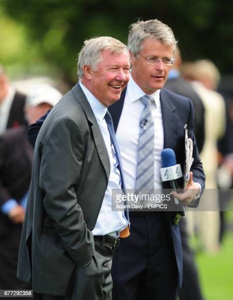 Manchester United Manager Sir Alex Ferguson waits to be interviewed by Chanel 4's Mike Cattermole