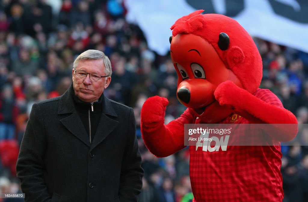 Manchester United Manager Sir <a gi-track='captionPersonalityLinkClicked' href=/galleries/search?phrase=Alex+Ferguson&family=editorial&specificpeople=203067 ng-click='$event.stopPropagation()'>Alex Ferguson</a> walks with Mascot Fred the Red prior to the FA Cup sponsored by Budweiser Sixth Round match between Manchester United and Chelsea at Old Trafford on March 10, 2013 in Manchester, England.