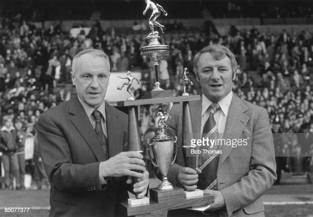 Manchester United manager Tommy Docherty receives an award from former Liverpool manager Bill Shankly 4th May 1976
