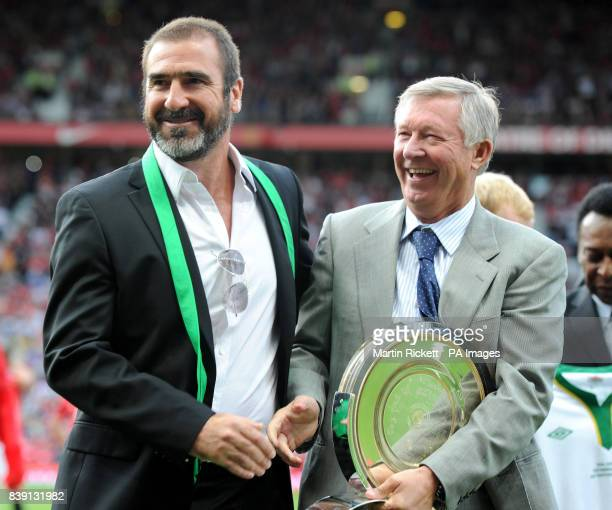 Manchester United manger Alex Ferguson with New York Cosmos manager Eric Cantona during the Paul Scholes Testimonial match at Old Trafford Manchester