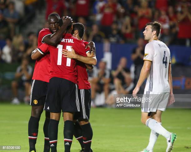 Manchester United Marcus Rashford Anthony Martial and Henrikh Mkhitaryan celebrate their goal as Los Angeles Galaxy's Dave Romney looks on during the...