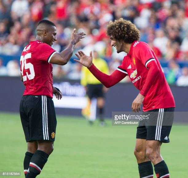 Manchester United Marouane Fellaini left celebrates his goal with teammate Antonio Valencia against Los Angeles Galaxy during the first half of a...