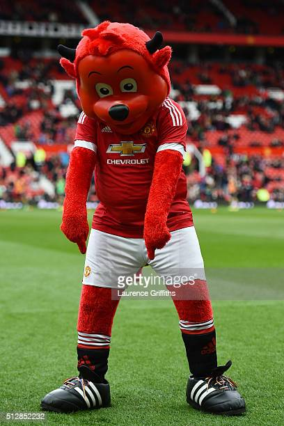 Manchester United mascot Fred the Red points at his rainbow laces during the Barclays Premier League match between Manchester United and Arsenal at...