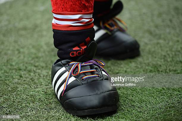 Manchester United mascot Fred the Red wears rainbow laces during the Barclays Premier League match between Manchester United and Arsenal at Old...